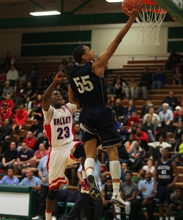 Canyon Springs' Jordan Davis shoots over Valley's Nick Brannon during the Sunris ...