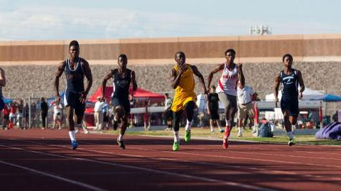 Bonanza's Jayveon Taylor, center in yellow, takes the lead during the boys 100-meter d ...