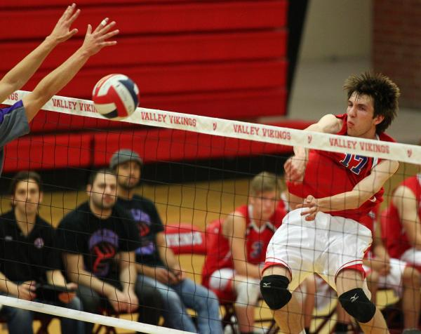 Valley's Jack Heavey goes up for a kill