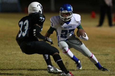 Green Valley's Markus Varner looks to get past Canyon Springs' Christian Minor o ...