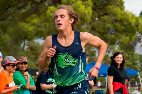 Austin Rogers, of Green Valley High School, runs toward the finish line during the Cross Cou ...