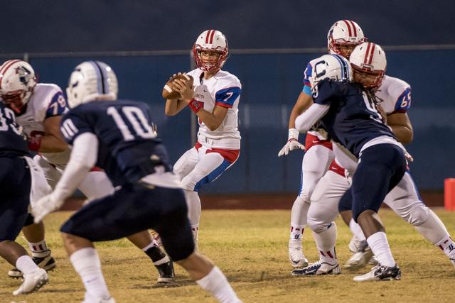Liberty Patriots quarterback Kenyon Oblad (7) drops back to throw against the Centennial Bul ...