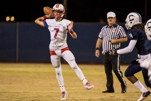 Liberty Patriots quarterback Kenyon Oblad (7) throws the ball against the Centennial Bulldog ...