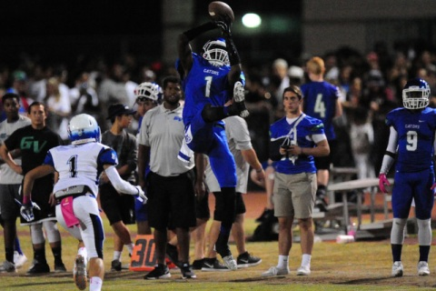 Green Valley Gators wide receiver Marquez Powell catches a pass for a first down against Bas ...