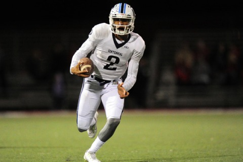 Centennial quarterback Jamaal Evans rushes against Arbor View in the first half of their pre ...