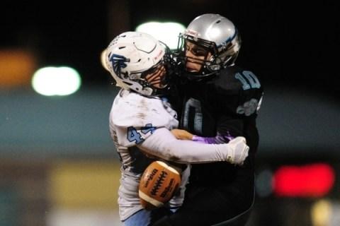 Silverado quarterback Micah Weber fumbles as Foothill linebacker Kealil Maruyama (44) tackle ...