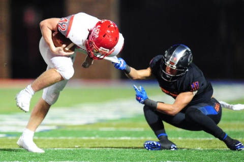 Bishop Gorman free safety Damuzhea Bolden (11) goes to tackle Arbor View fullback Andrew Wag ...