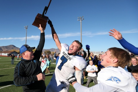 Pahranagat Valley Head Coach Ken Higbee and Shawn Wadsworth celebrate after defeating Whitte ...