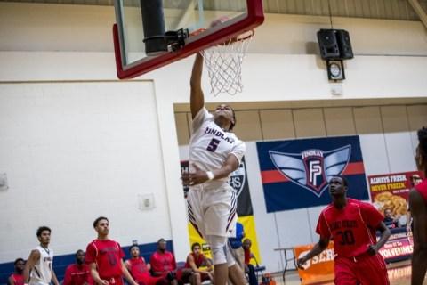 P.J. Washington of Findlay Prep dunks the ball against Planet Athlete Academy at Henderson I ...