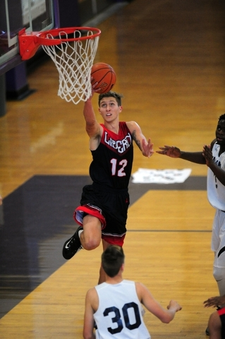 Liberty guard Kyle Thaxton scores on a layup attempt against Coral Academy in the first half ...