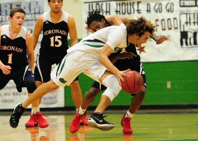 The arm of Green Valley guard Xavier Jarvis gets caught around the neck of Coronado guard Ni ...