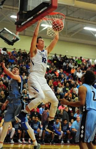 Bishop Gorman forward Zach Collins (12) dunks in front of Centennial guard Warren Price (12) ...