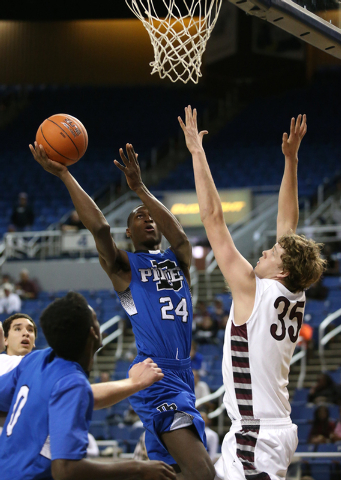 Desert Pines' Nate Grimes, seen shooting over Elko defender Brian Pearson during a Div ...