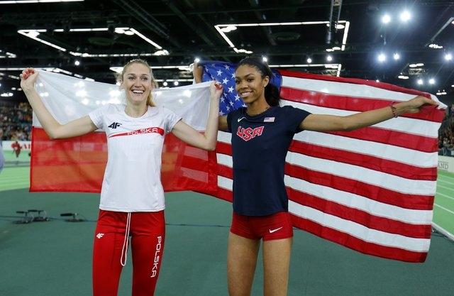 Bronze medal winner Kamila Licwinko of Poland (L) and gold medal winner Vashti Cunningham of ...