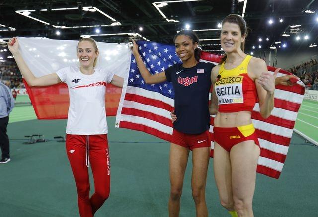 Bronze medal winner Kamila Licwinko of Poland, gold medal winner Vashti Cunningham of the U. ...