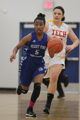 Chrystian Myles (5) brings the ball down the court against Tech in the Lady Wolves Holiday T ...