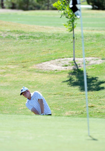 Shadow Ridge's Benjamin Davis shoots for the green on the fifth hole during the final ...