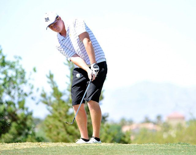 Shadow Ridge's Benjamin Davis chips on the fourth hole during the final round of the S ...