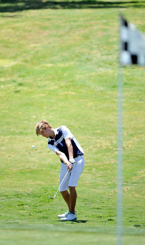 Boulder City's Luke Logan shoots on the fifth hole during the final round of the Divis ...