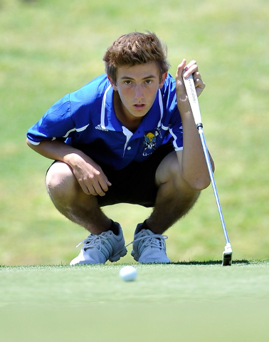 Moapa Valley's Jacob Causey lines up his shot on the fifth hole during the final round ...