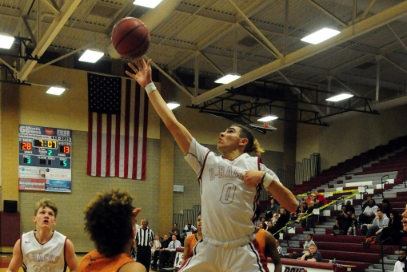 Desert Oasis guard Andrue Aguilera, seen shooting against Legacy in a Sunset Region playoff ...