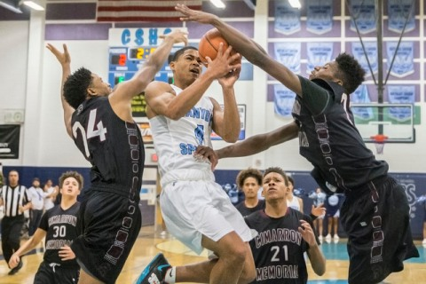 Canyon Springs' Kevin Legardy (4) drives past Cimarron-Memorial's Brian Washingt ...