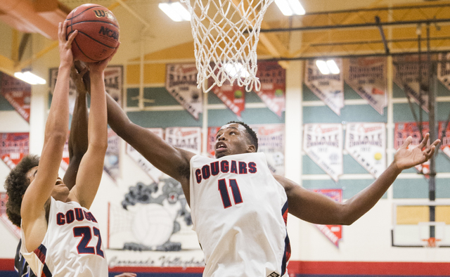 Coronado's Will Weems (11) and Patrick Simms (22) compete for a rebound on Monday, Dec ...