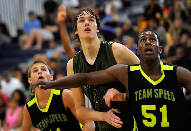 Oakland Soliders' Stephen Zimmerman, center, looks for a rebound against Team Speed&#8 ...