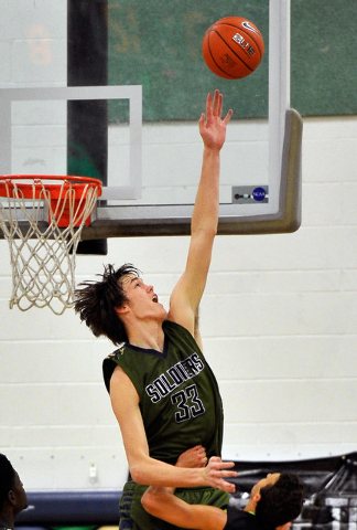 Oakland Soliders' Stephen Zimmerman goes up to block a shot during a Las Vegas Classic ...