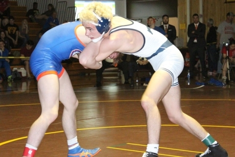 Shadow Ridge's Brendt Burleson (right) ties up with top-seeded Mason Campbell of Bisho ...