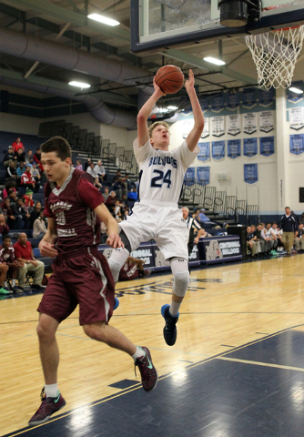Centennial forward Garett Scheer (24) goes up for a shot past Cimarron-Memorial guard Austin ...
