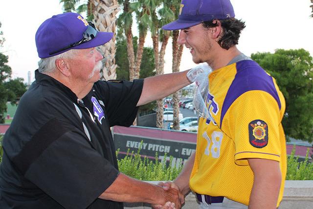 Durango coach Tom Appleyard congratulates starting pitcher Brayden Williams, who pitched a c ...