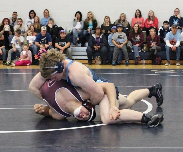 Centennial's Hunter Brown works his opponent from Cimarron-Memorial, during Saturday's 1 ...