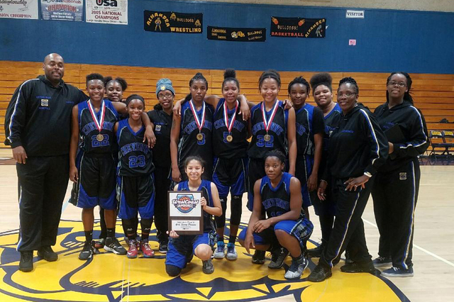 Cheyenne's players and coaches pose with the second-place trophy from the West Coast J ...
