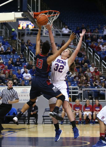 Reno's Morgan McGwire blocks a shot by Liberty's Aubre' Fortner during the ...