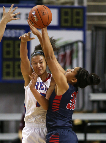 Liberty's Paris Strawther pressures Shalen Shaw of Reno during the Division I champion ...