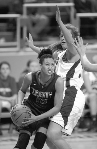 Liberty's Aubre' Fortner drives past Reno's Morgan McGwire during the Divi ...