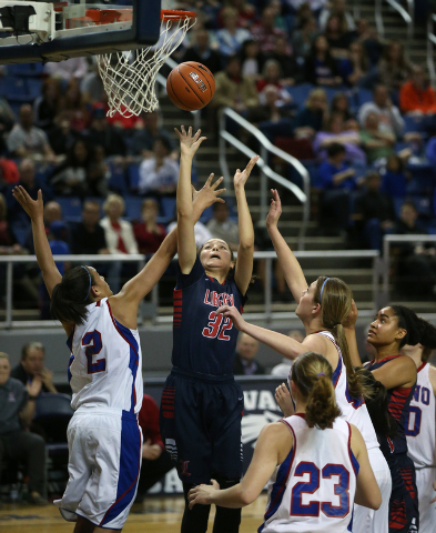 Liberty's Jazmin O'Bannon shoots through a crowd of Reno defenders during the Di ...