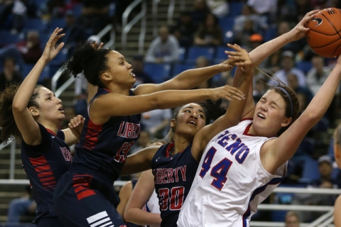 Reno's Mallory McGwire, right, fights for a rebound during the state championship game ...