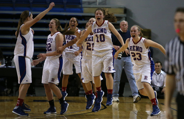 The Reno Huskies clear the bench after defeating the Liberty Patriots 50-39 to clinch the Di ...