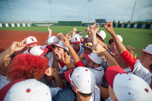 Liberty players celebrate a 3-2 win over Centennial in the Division I state tournament on Fr ...