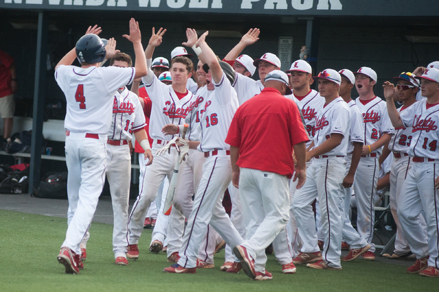 The Liberty bench comes out to greet Jay Martz after scoring the tying run against Centennia ...