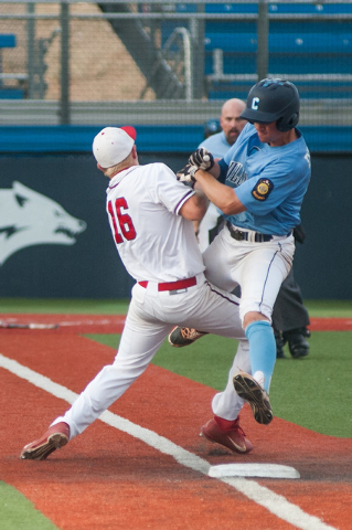 Liberty's Justin Lutes collides with Centennial's Jared Drizin at first base in ...