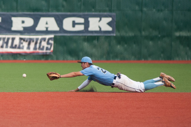 Centennial's Jake Portaro dives for the ball while playing against Liberty in the Divi ...