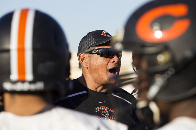 Chaparral head coach Paul Nihipali speaks to his players during a practice on Thursday, Nov. ...