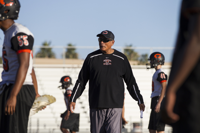 Chaparral head coach Paul Nihipali watches his players stretch during practice on Thursday, ...