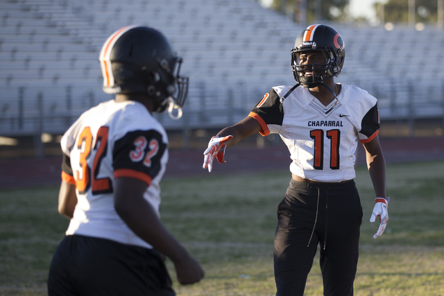 Chaparral's Kentrell Petite (11) reaches his hand to a coach for a handshake during pr ...