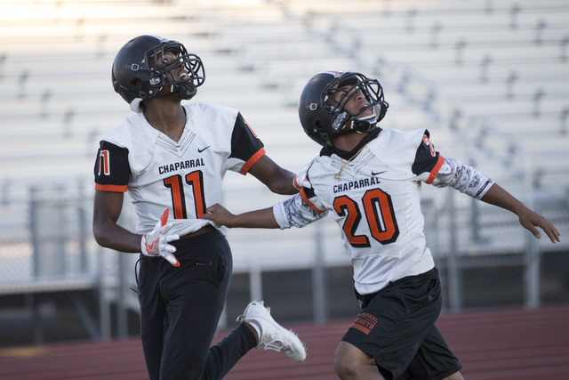 Chaparral's Kentrell Petite (11) runs a pass drill with Dylan Disroe (20) during pract ...
