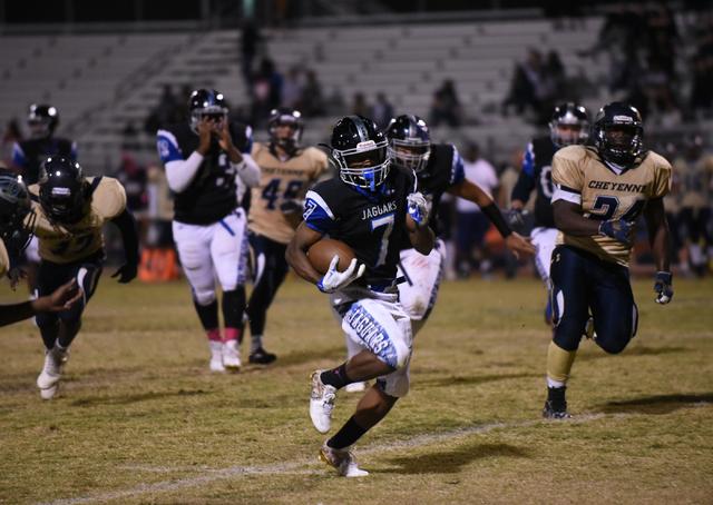 Desert Pines Isaiah Morris (7) runs down field against the Cheyenne defense during their foo ...