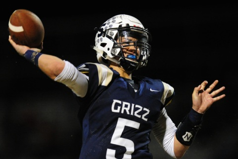 Spring Valley quarterback K.C. Moore passes against Desert Oasis in the first half of their ...